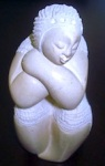 carved_stone_woman_sitting_haiti_1